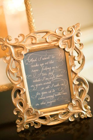 quote-lyrics-in-gold-frame-calligraphy-katrina-catholic-california-wedding-written-ceremony-decor
