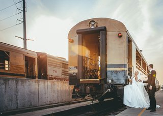 bride-and-groom-boarding-napa-valley-wine-train-for-reception