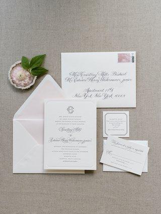 the-lettered-olive-wedding-invitation-suite-light-pink-envelope-liner-grey-calligraphy-monogram