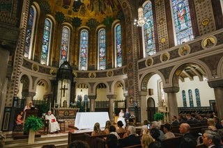 catholic-church-wedding-with-tall-ceilings-and-stained-glass-windows