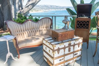 oceanfront-wedding-with-vintage-furnishings-at-outdoor-lounge