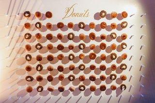 wedding-reception-dessert-ideas-take-home-favor-doughnut-wall