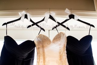 wood-hangers-maid-of-honor-bride-bows-sweetheart-neckline-dresses-black-white-hanging-window-wedding