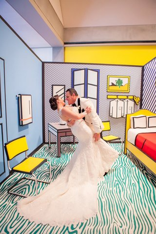 bride-in-martina-liana-trumpet-gown-groom-in-white-tuxedo-jacket-roy-lichtenstein-exhibit