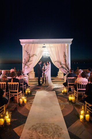 jewish-ceremony-after-sunset-with-chandelier-under-chuppah-for-lighting
