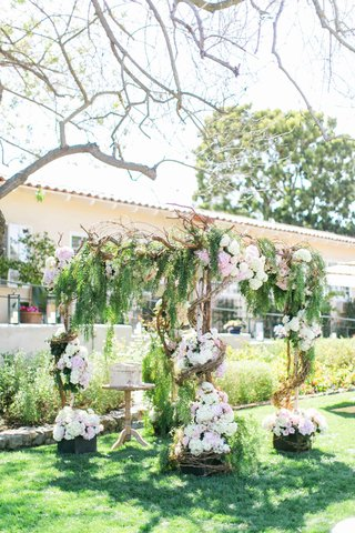 wedding-ceremony-structure-with-birch-tree-wrap-around-vines-greenery-and-white-and-pink-flowers