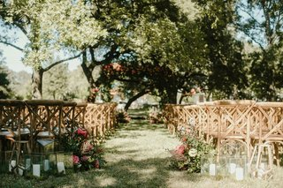 wedding-reception-wood-vineyard-chairs-candle-lanterns-terrarium-greenery-trees-blue-sky
