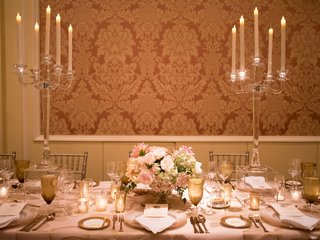 wedding-reception-damask-wallpaper-crystal-candelabra-low-centerpiece-pink-white-flowers-gold