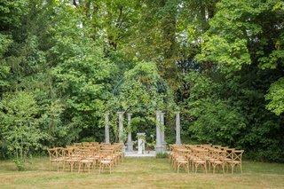 wedding-ceremony-garden-venue-in-france-wood-vineyard-chairs-gazebo-columns-iron-arch-greenery