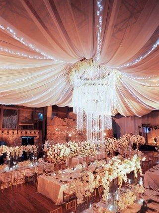 wedding-reception-guatemala-ruins-chandelier-flower-with-drapery-twinkle-lights-overhead