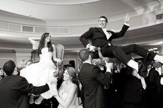 black-and-white-photo-of-bride-and-groom-during-hora-wedding-dance-jewish-tradition