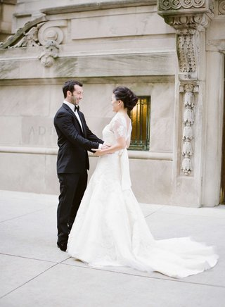 bride-and-groom-smile-at-each-other-during-first-look-in-chicago-wedding-photo