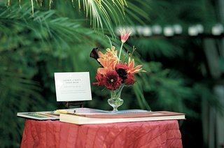 red-table-with-guestbook-and-markers-at-outdoor-wedding