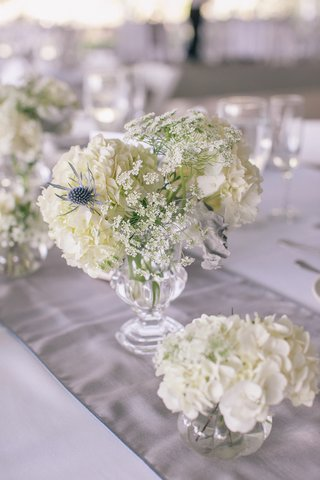 small-glass-urn-filled-with-blue-thistles-and-lace