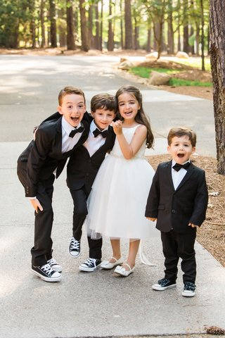 flower-girl-in-white-dress-and-three-ring-bearers-in-little-tuxedos-bow-ties-and-converse-sneakers