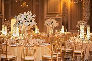 gold-tablescapes-with-gold-table-linens-chairs-and-charger-plates-tall-floral-arrangements