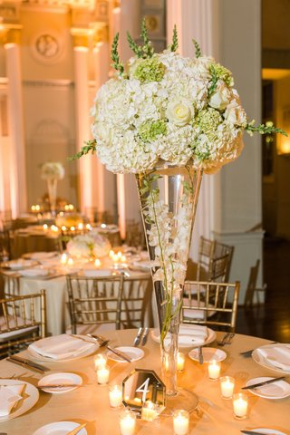 floral-centerpiece-with-glass-vase-hydrangeas-roses-white-ivory-orchids-greenery-candles-mirror