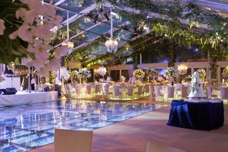 glass-a-line-tent-with-vines-and-white-flower-chandeliers