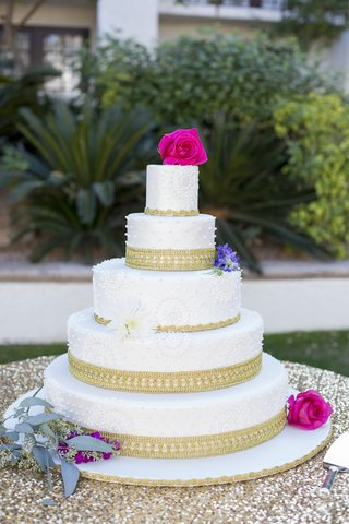 south-asian-wedding-inspiration-ornate-white-wedding-cake-with-gold-border-and-magenta-roses