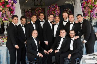 groom-and-groomsmen-in-black-tuxes-and-bow-ties