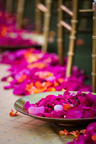 gold-bowls-at-indian-hindu-wedding-ceremony-filled-with-pink-and-orange-flower-petals