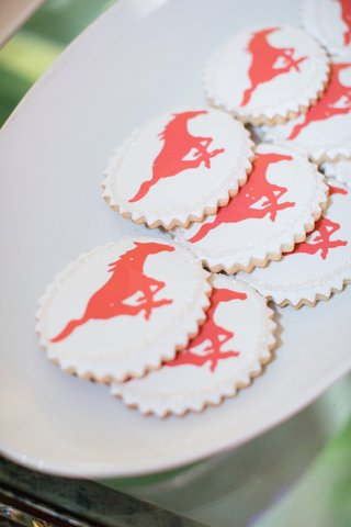 white-cookies-with-scallop-edges-and-red-galloping-horse