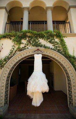 vera-wang-wedding-dress-hanging-from-terranea-balcony