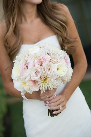 bride-holding-white-and-pink-rose-flower-bouquet