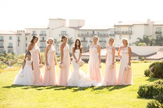 bride-and-flower-girl-with-asymmetrical-bridesmaid-dresses