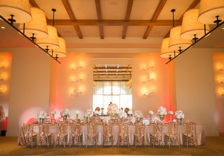 long-rectangular-reception-table-with-pink-and-white-flowers