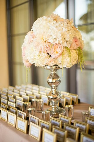 gold-frame-escort-cards-with-white-and-blush-flower-arrangement