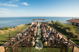 grass-lawn-ceremony-with-ocean-views-and-gated-entry