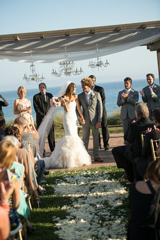 bride-and-groom-under-chandelier-chuppah-at-terranea