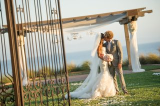 bride-and-groom-kiss-at-terranea-resort-ceremony