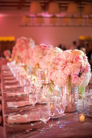 long-rectangular-table-topped-with-pink-florals