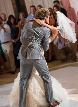 groom-dipping-and-kissing-bride-on-dance-floor