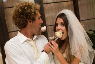 bride-and-groom-feed-scoops-of-ice-cream