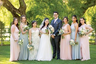 bride-with-male-bridesmaid-bridesman-and-bridesmaids-in-pink-and-green-dresses-pastel-tones
