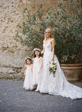 bride-in-strapless-wedding-dress-sweetheart-neckline-two-flower-girls-white-flower-crowns-italy