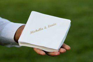 white-beverage-napkin-with-gold-couple-names