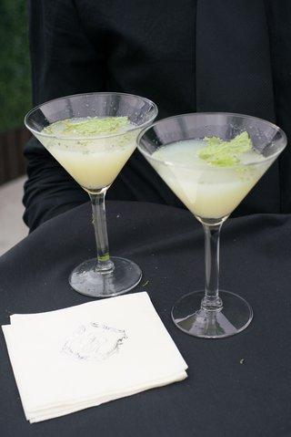martini-glass-with-lemon-signature-cocktail-and-green-garnish-monogram-napkins