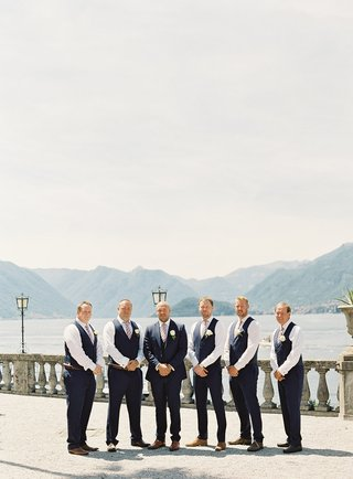 wedding-on-lake-como-in-italy-destination-groom-in-navy-suit-and-groomsmen-in-navy-slacks-and-vests