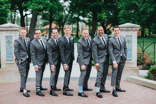 groom-and-groomsmen-in-grey-suits-black-ties-quirky-socks