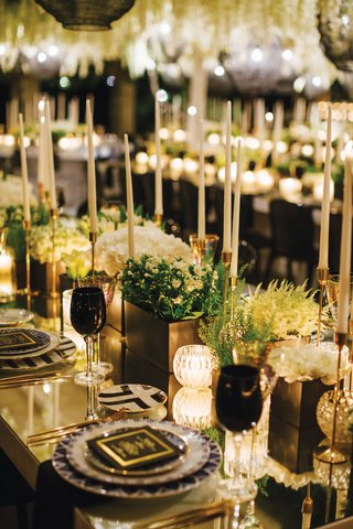 wedding-reception-modern-black-white-geometric-designs-taper-candles-greenery-black-glassware-goblet