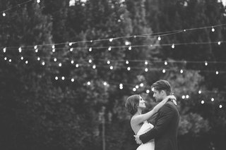black-and-white-photo-of-bride-in-a-strapless-anne-barge-dress-dances-with-groom-at-eden-gardens-ca