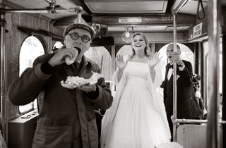 when-the-bride-stepped-on-the-trolley-to-say-hello-to-her-guests-the-tour-guide-was-in-the-middle-o