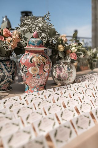 wedding-reception-escort-card-table-boho-chic-vintage-style-painted-jars-and-flowers