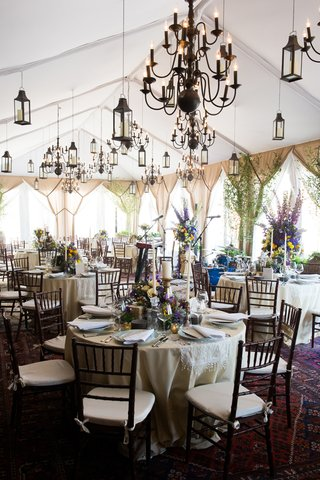 tented-rooftop-space-vintage-chandeliers-round-tables-new-york-city-bridal-party-event