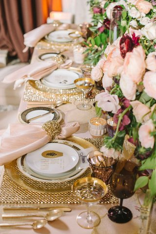 gold-placemats-gold-rimmed-glasses-gold-napkin-rings