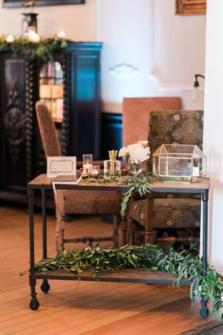 wedding-reception-or-ceremony-with-wood-bar-cart-wheels-greenery-and-gold-terrarium-guest-book